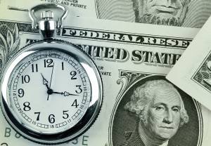 Stopwatch and dollar bills.