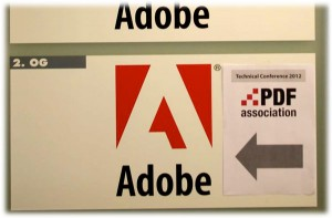 Adobe's door sign and paper showing the PDF Conference is here!