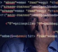 Developer examines code.
