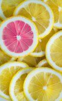A pink lemon-slice among yellow slices.
