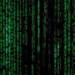 Vertical streams of code.